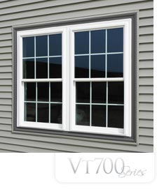 700vt Aspect Series Windows with white trim on the side of a building