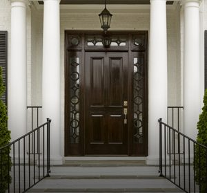 Dark front door with white columns